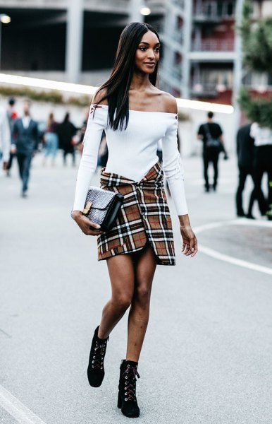 Off-the-shoulder white sweater with red and black checkered mini skirt