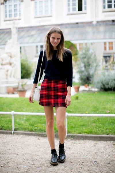 black three-quarter sleeve sweater with red checkered mini skirt