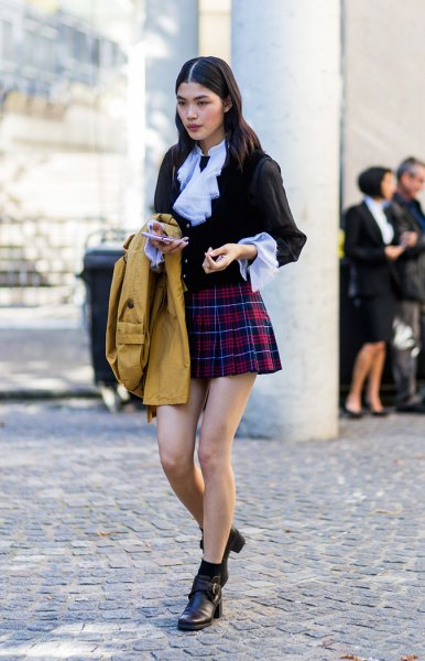 black blouse with light blue collar and red mini raid skirt
