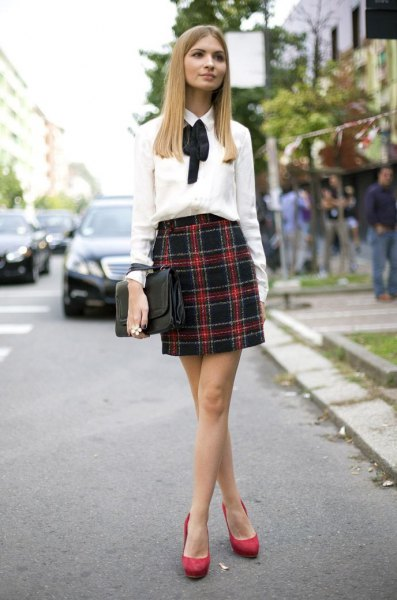 white bow shirt with bow and dark blue and red mini skirt