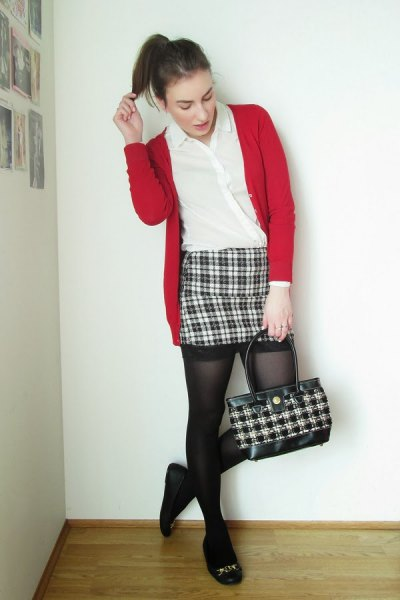 red cardigan with black and white checked mini skirt