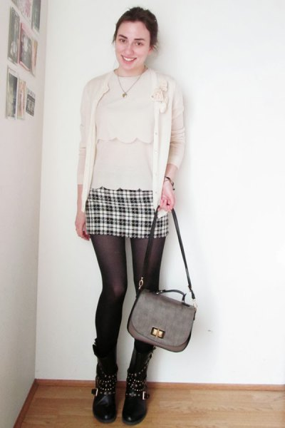 light pink blouse with matching cardigan and mini skirt