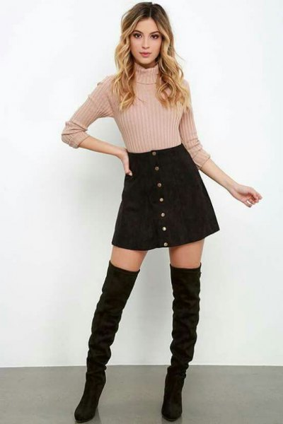 pink knitted sweater with black cord skirt