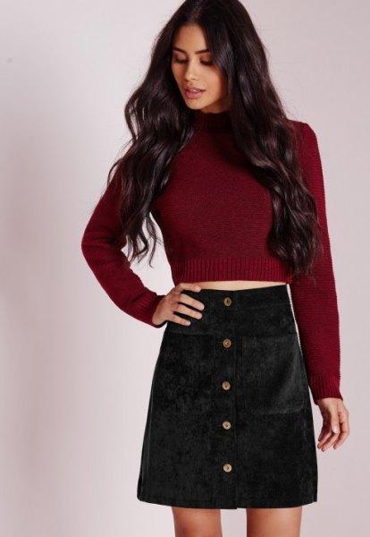 burgundy knit sweater with black cord mini skirt