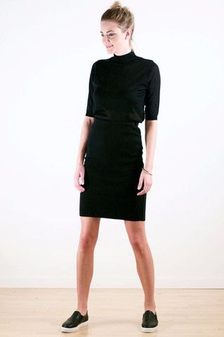 black, half-sleeved sweater with stand-up collar and knee-length skirt with high waist