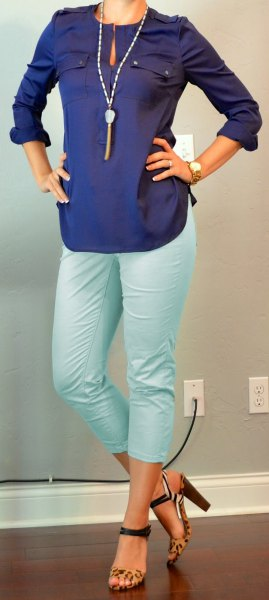 Dark blue long sleeve keyhole blouse with white, cropped pants