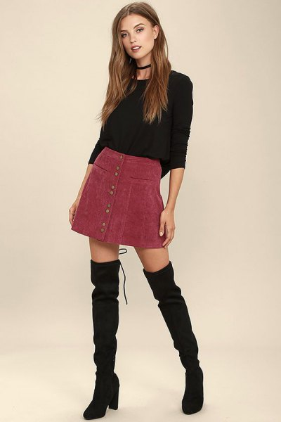 black, tailored sweater with round neck and burgundy cord mini skirt