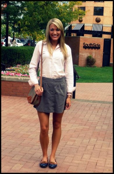 white shirt with buttons and gray mini skirt with elastic waist