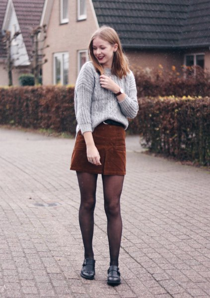gray, ribbed, rough knitted sweater with brown cord mini skirt