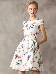 white dress with short sleeves and flared mini flower pattern