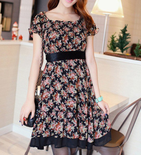 Blush a knee-length dress with a pink and black belt and floral pattern