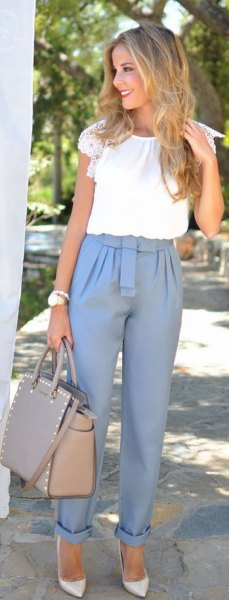 pink dress pants with cuff and white short sleeve blouse