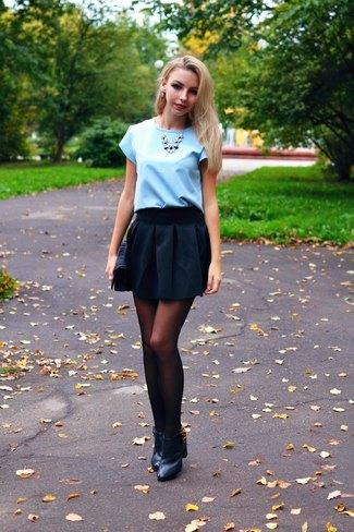 Light sky blue blouse with black miniskirt