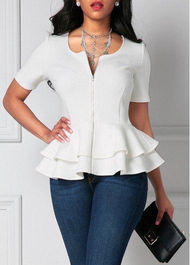 white short-sleeved peplum blouse with dark blue skinny jeans