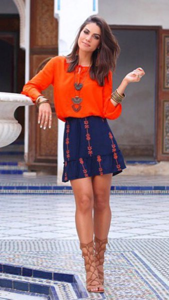 orange blouse with a round neckline and blue miniskirt