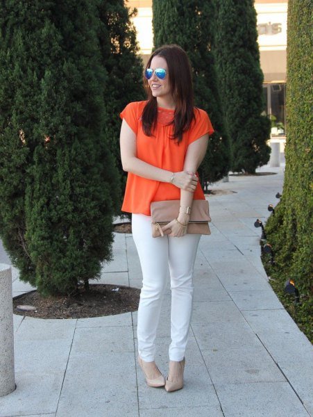 orange short sleeve blouse with white slim fit jeans