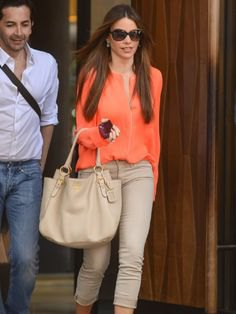 orange chiffon blouse with light green slim fit jeans with cuffs