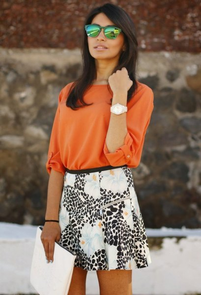 orange blouse with white and black printed skater skirt