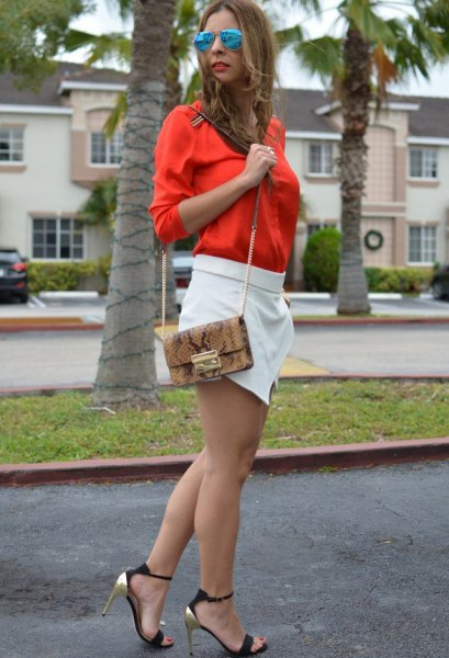 bright orange shirt with button and white mini-skort