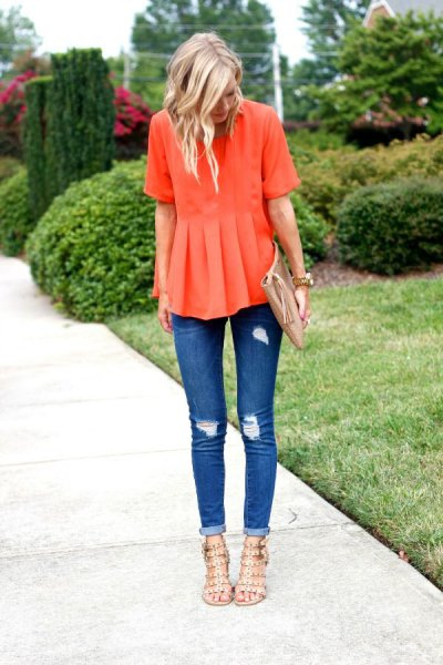 orange peplum blouse with torn skinny jeans