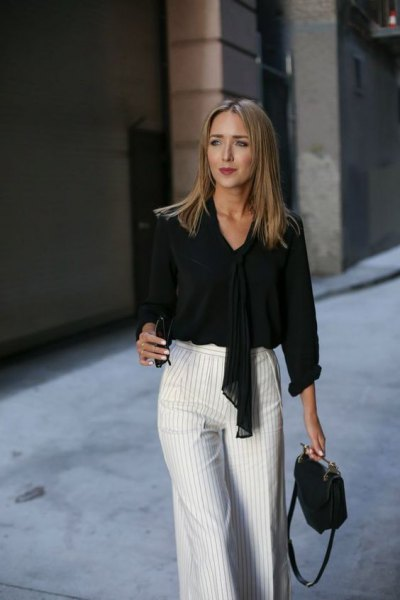 black tie blouse with gray and white striped trousers with wide legs
