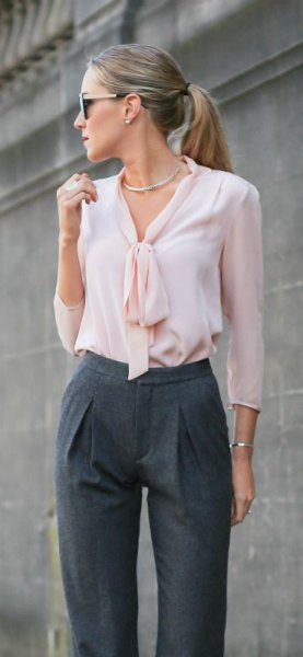 white silk blouse with tie neck and gray chinos with high waist
