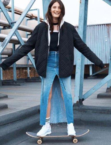 black oversized bomber jacket with high waisted jeans maxi slit skirt