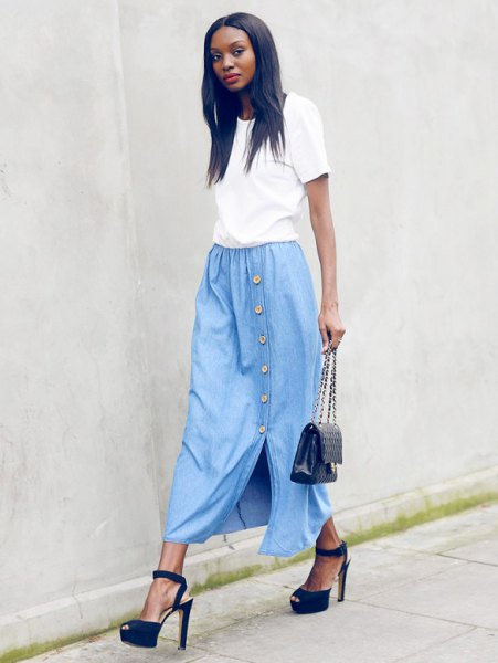 white t-shirt with a sky blue long denim skirt