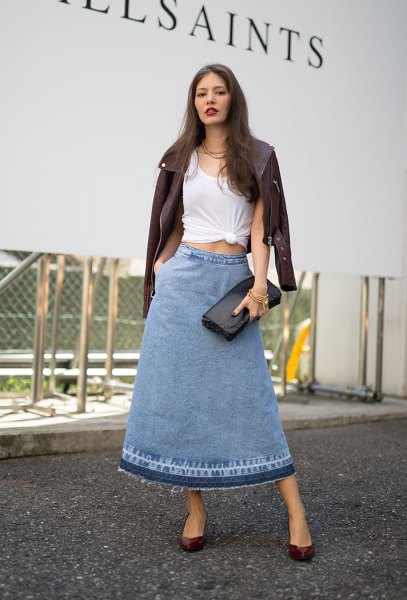 white knotted t-shirt with black leather jacket and long flared skirt