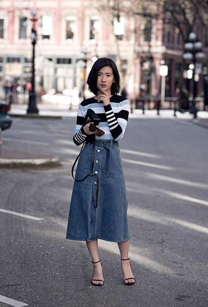 black gray and white striped sweater with blue midi button in front skirt