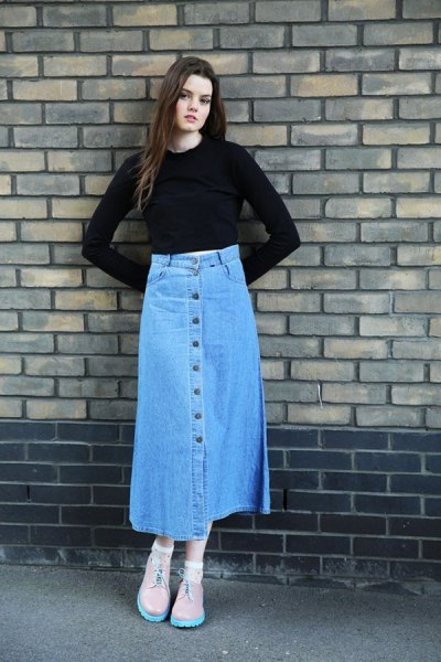 black, slightly shortened bell sleeve top with blue skirt with long denim button on the front