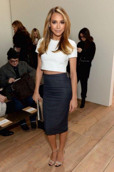 white, short t-shirt with black, form-fitting midi skirt