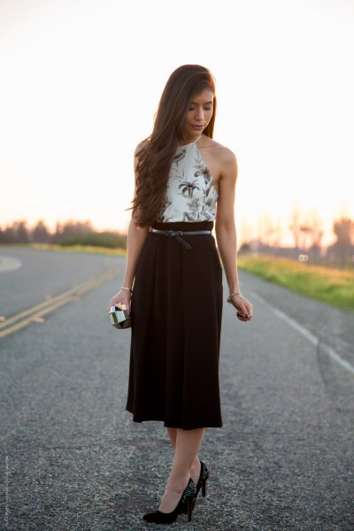 white halter top with floral pattern and black midi high skirt