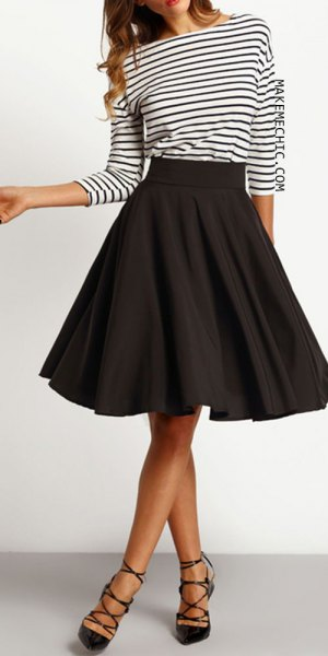black and white striped long-sleeved t-shirt with a knee-length skater skirt
