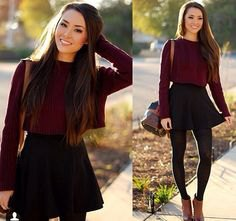 gray slim-fit sweater with a round neckline and black skater skirt with a high waist