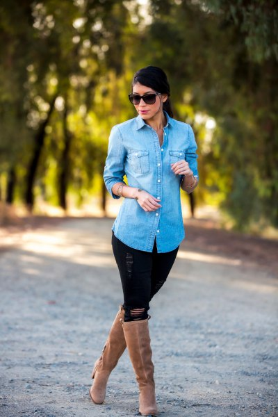 Light blue denim shirt with black jeans and knee high boots with camel heel