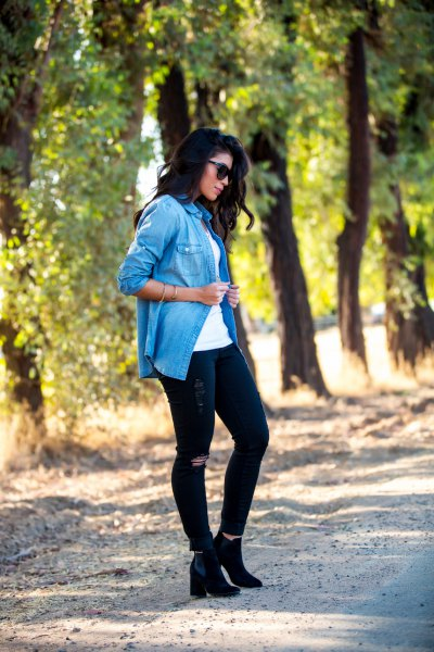 blue casual blouse with black jeans and high-heeled boots
