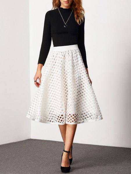 black crew-neck sweater and white, semi-transparent, high-waisted midi skirt