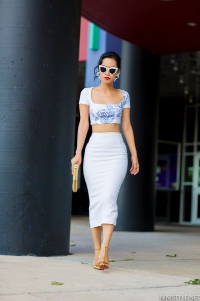 blue printed, short cut, form-fitting t-shirt with high waisted white skirt