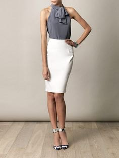 gray halter top with tie neck and high waisted white skirt