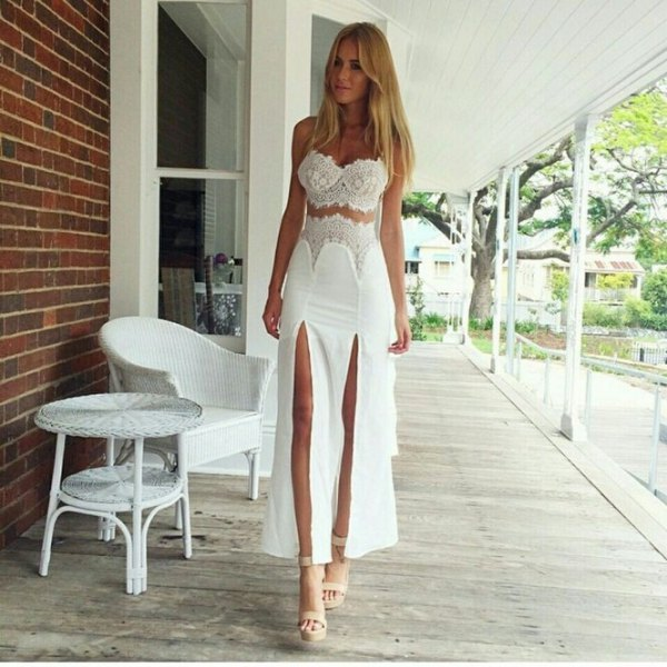 white two-piece ball gown with two slits and pink heels