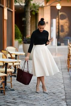 black shirt with buttons and white midi skirt with high waist