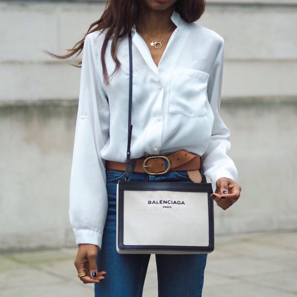 white silk shirt with buttons and blue jeans with high waist