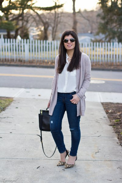 white silk blouse with button placket and gray cardigan