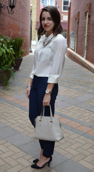 Silk button blouse with black slim fit jeans and heels