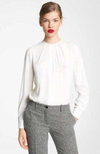 white long-sleeved blouse with a round neckline and relaxed fit and tweed pants