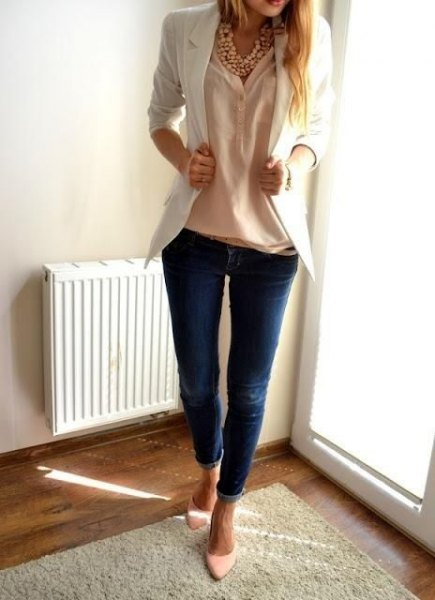 cream blouse with ivory blazer and dark blue skinny jeans