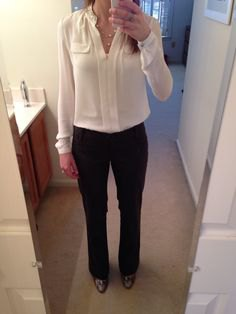 cream-colored blouse with black chinos and leather ankle boots