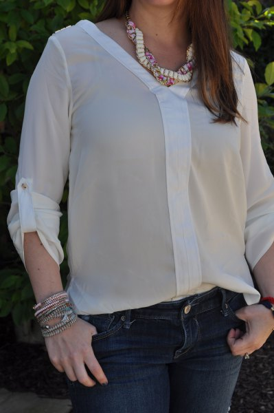 semi-transparent chiffon blouse with dark blue skinny jeans