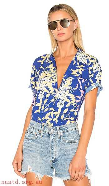 royal blue and white hiking shirt with floral print and denim shorts